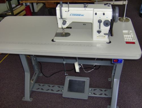 A 47 x 21 inches, adjustable height worktable