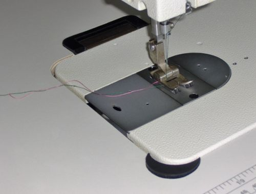 A button to release pressure on the presser foot