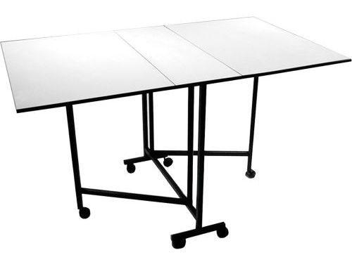 Drop leaf cutting table mounted on casters
