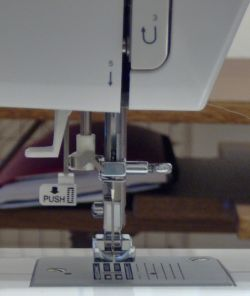 lever behind needle assembly