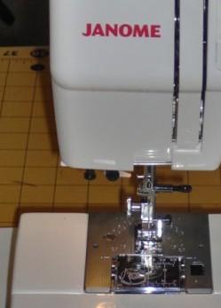 Horizontal, full rotary hook bobbin system