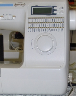 On board stitch selection guide and dial
