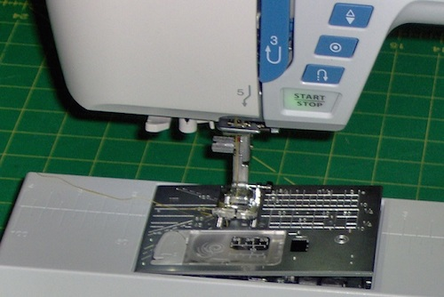 Needle plate pops up and slides off easily